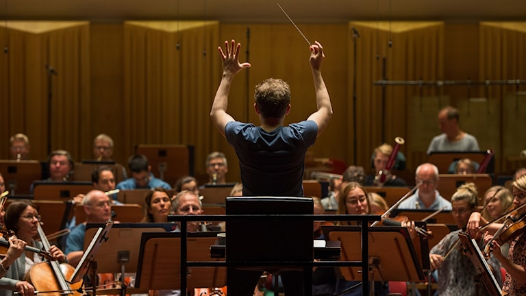 An orchestra in rehearsal.