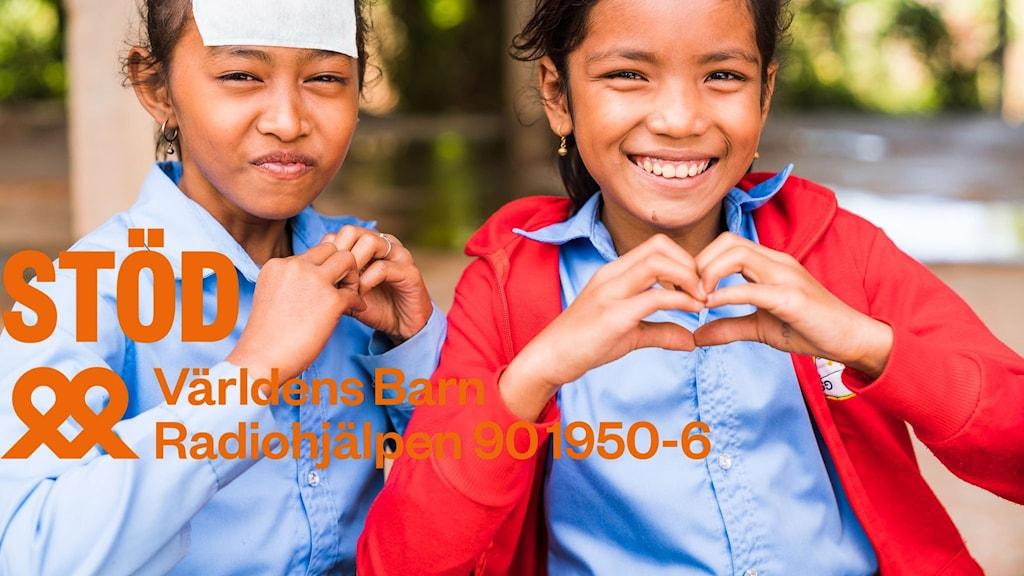 Två tjejer gör handhjärtan