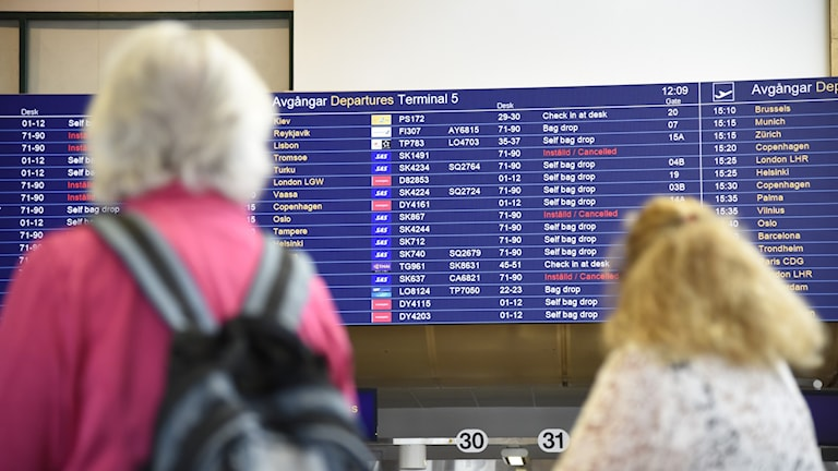 A board showing canceled flights at an airport.
