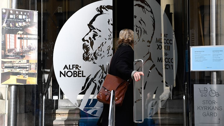 A woman opens the door of the Alfred Nobel Museum in Stockholm