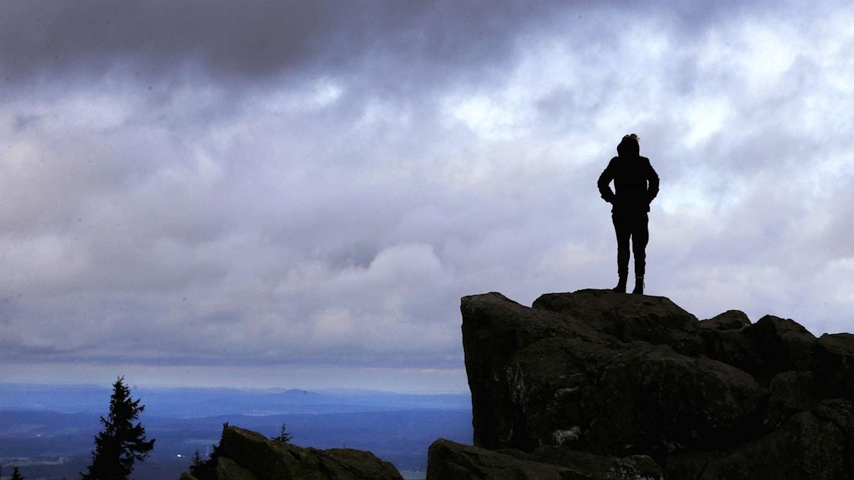 Person på bergstopp