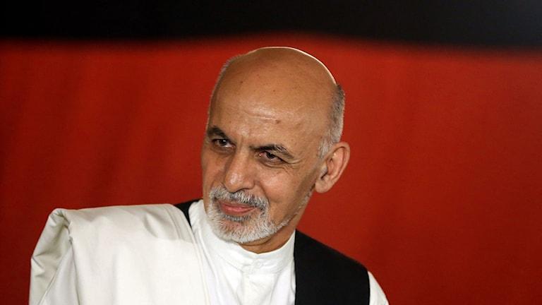 Porträtt på Afghanistans president Ashraf Ghani. Foto: Massoud Hossaini/TT/AP.