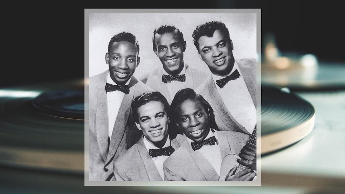 Curtis Mayfield tillsammans med sitt band The Impressions