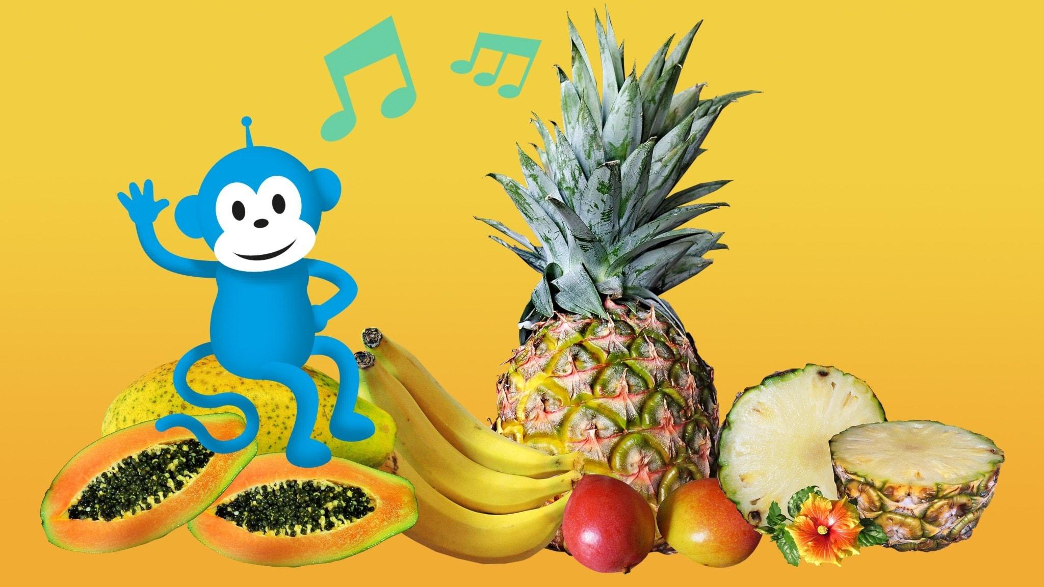 Radioapan med ett gäng frukter - ananas, bananer, papaya och mango.