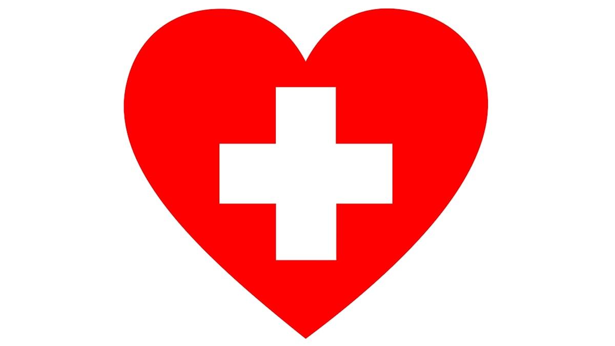 Ett rött hjärta på vit bakgrund. I mitten av hjärtat ett rött första-hjälpen-kors.