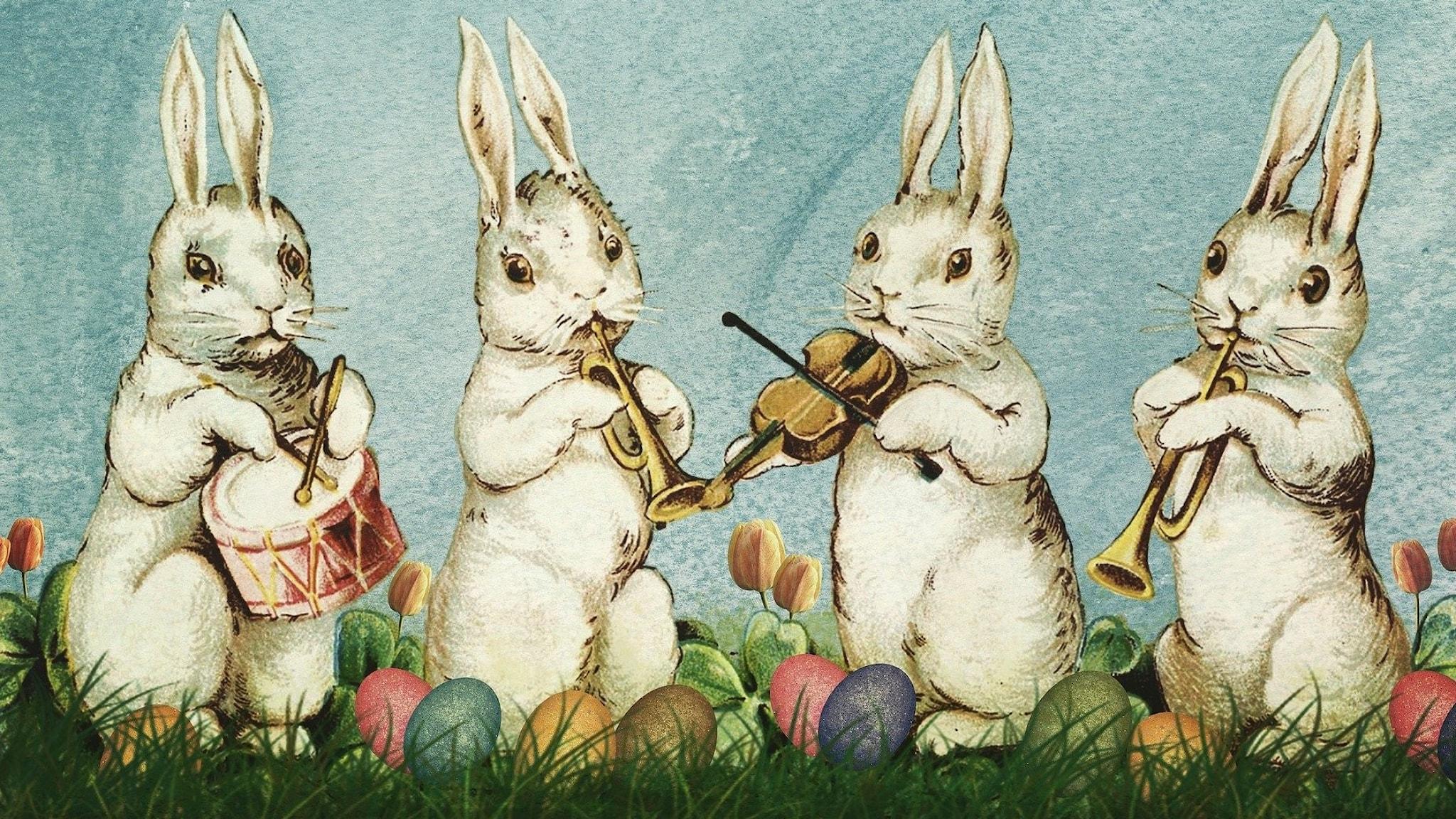 En ritad bild på fyra påskharar som spelar instrument.
