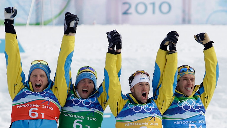 Sweden's Daniel Richardsson, Sweden's Johan Olsson and Sweden's Anders Soedergren, from left, celebrate their teammate Sweden's Marcus Hellner, front, after winning the gold medal during the Men's 4x10k relay at the Vancouver 2010 Olympics in Whistler, British Columbia, Canada, Wednesday, Feb. 24, 2010. (AP Photo/Elaine Thompson)