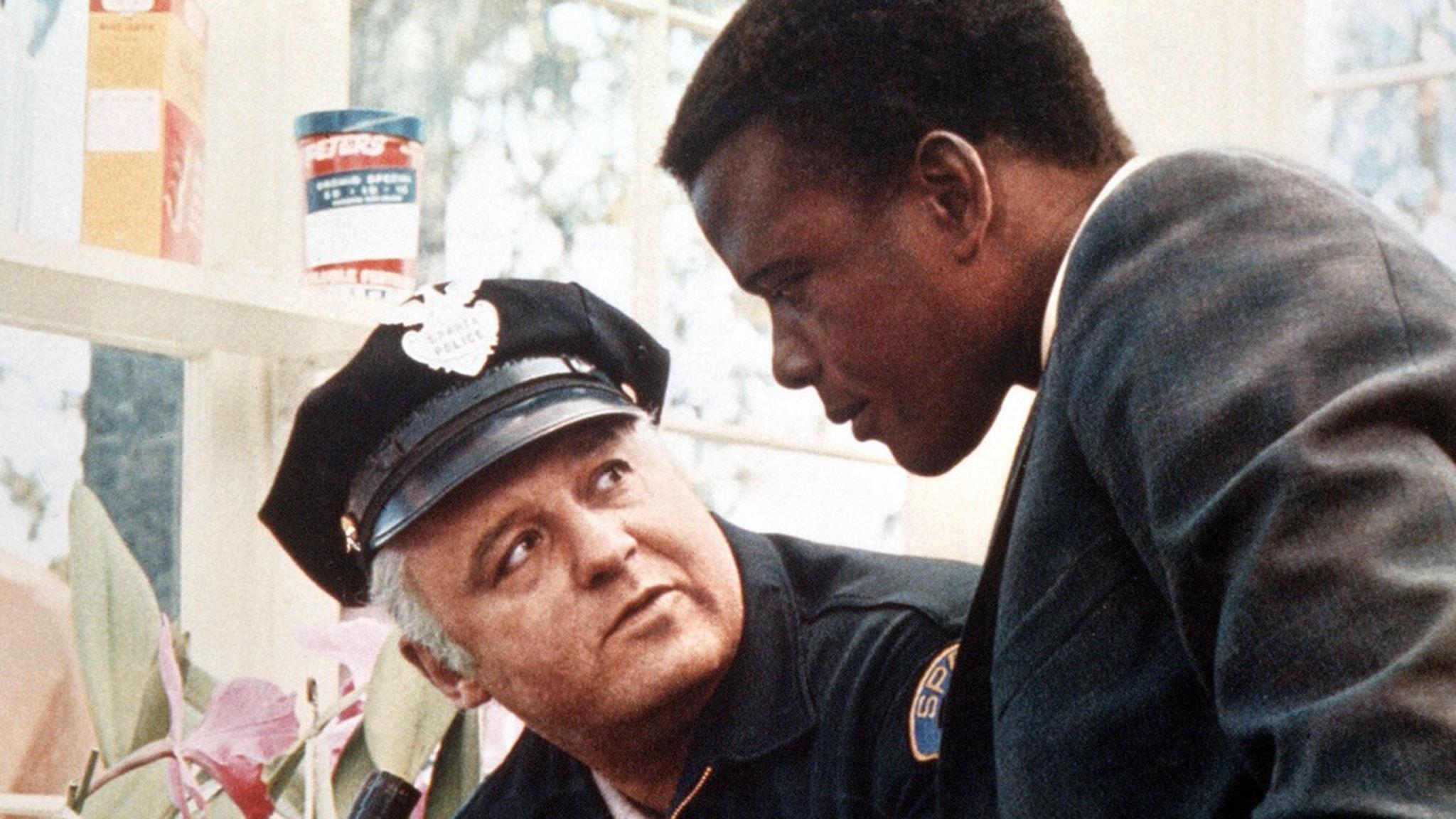 """Rod Steiger och Sidney Poitier i filmen """"I nattens hetta"""" (1967)."""