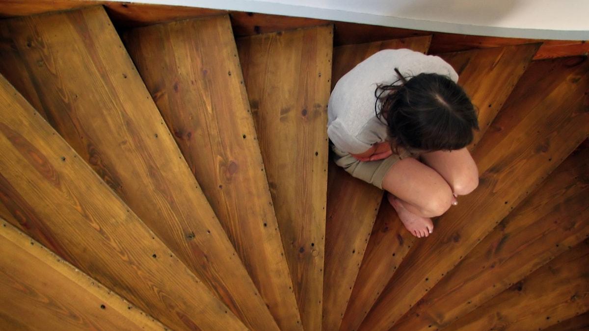Kvinna i trapp