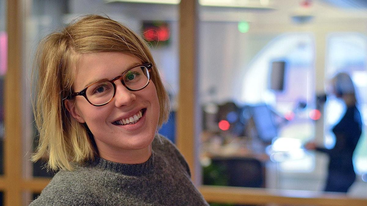 Kvinna i redaktionsmiljö