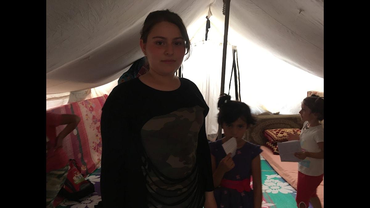 Khadija 15 år, går i gymnasiet i ett flyktingläger.