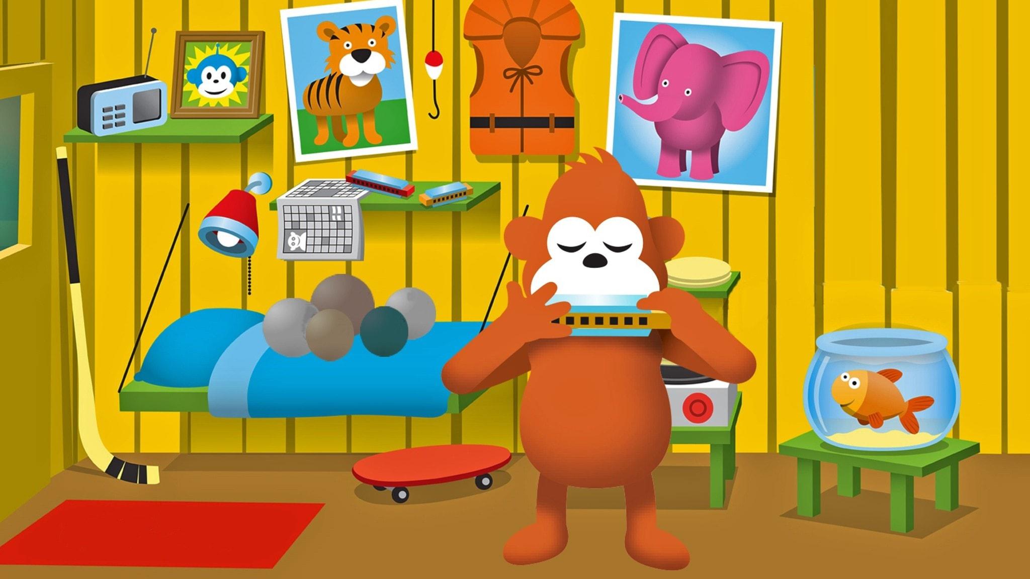 Gorilja soittaa huuliharppua huoneessan
