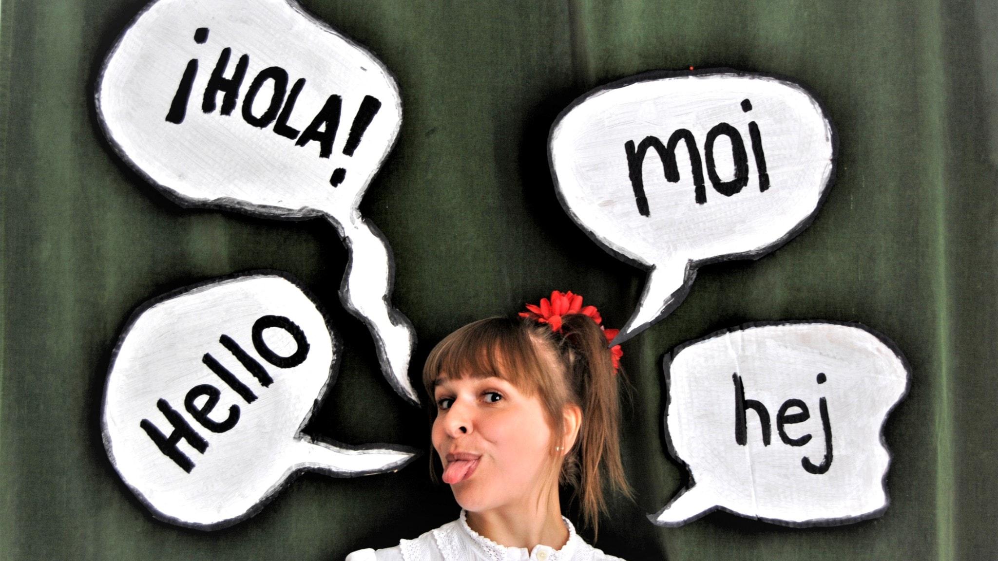 Milja ja puhekuplat joissa lukee hola, moi, hej ja hello