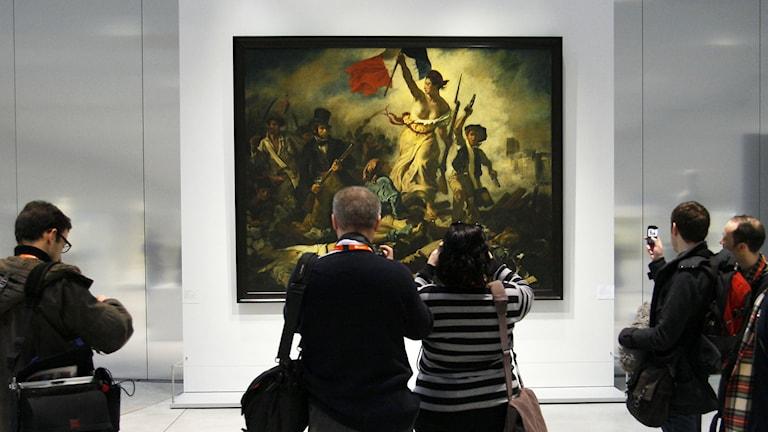 La Liberte Guidant le Peuple' en målning av Eugene Delacroix på Louvren. Foto: Michel Spingler / TT