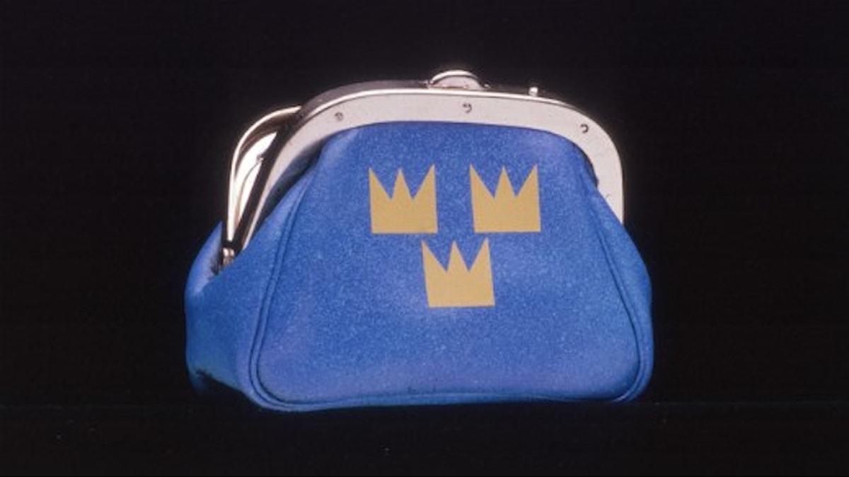 Plånbok med tre guldkronor