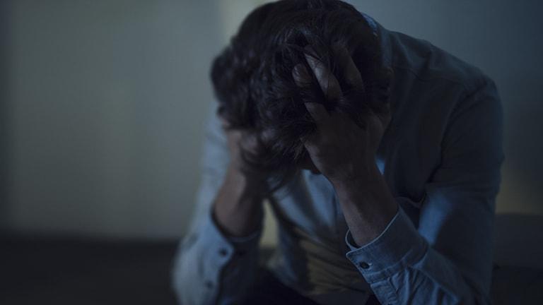 En person som är deprimerad.