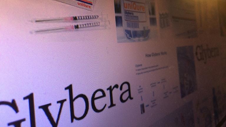 Glybera, varumärke plus diffusa foton. Avfotograferad bildskärm snett från sidan.