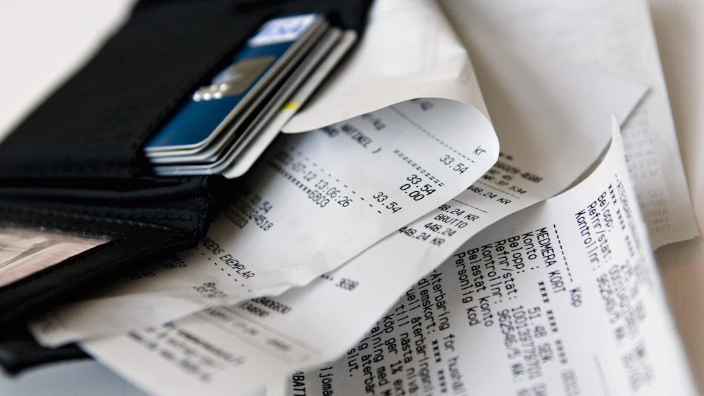 Plånbok och kvitton.