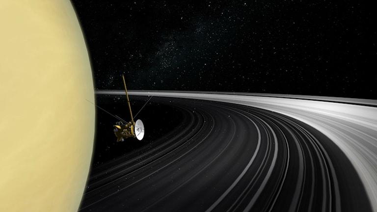 Bilden har skapats för att visa rymdsonden Cassini vid Saturnus ringar.