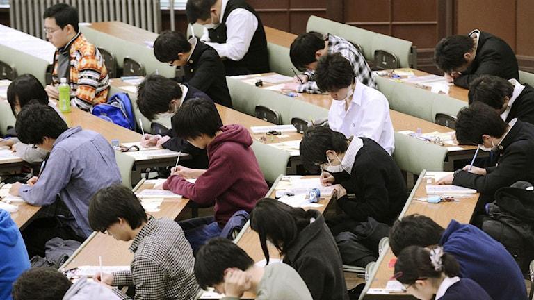 Elever i Japan under det globala kunskapstestet.