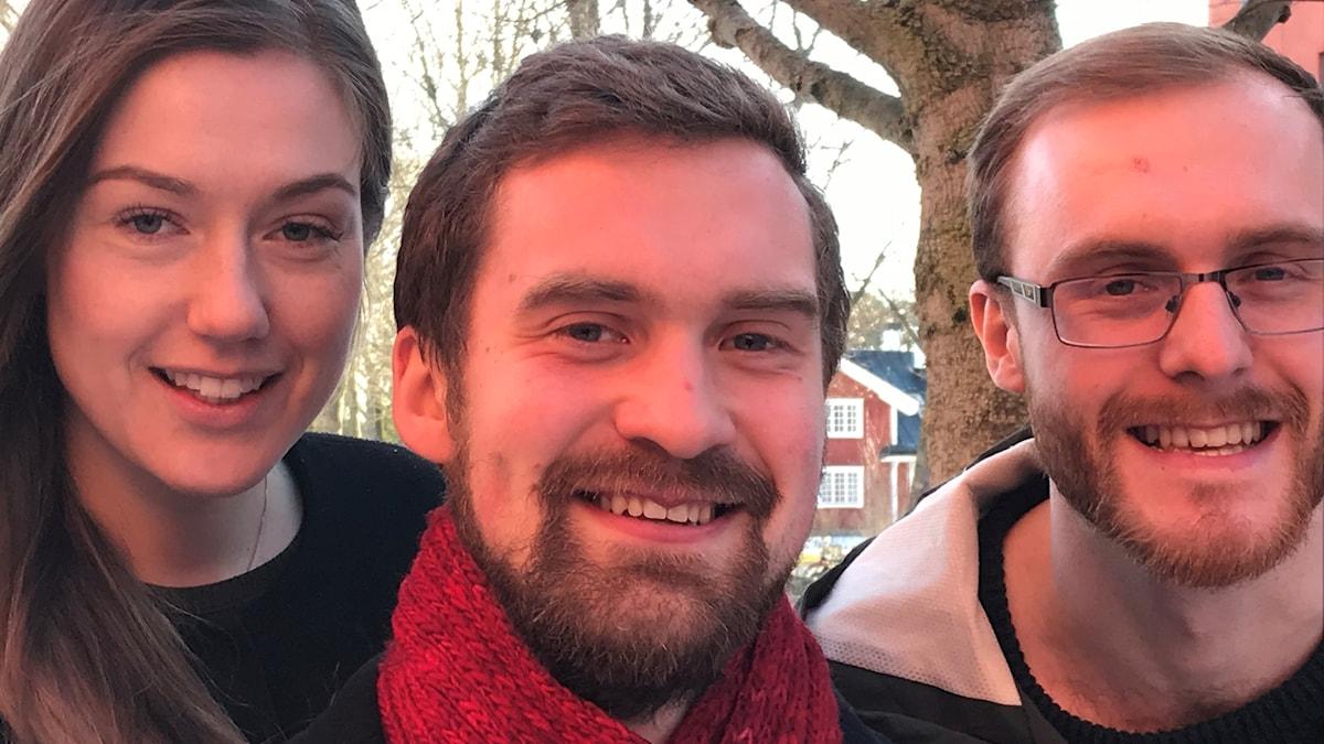 Närbild på tre leende ansikten. Emma Ekberg Berry,  Egil Schultz och Joakim Nyman.