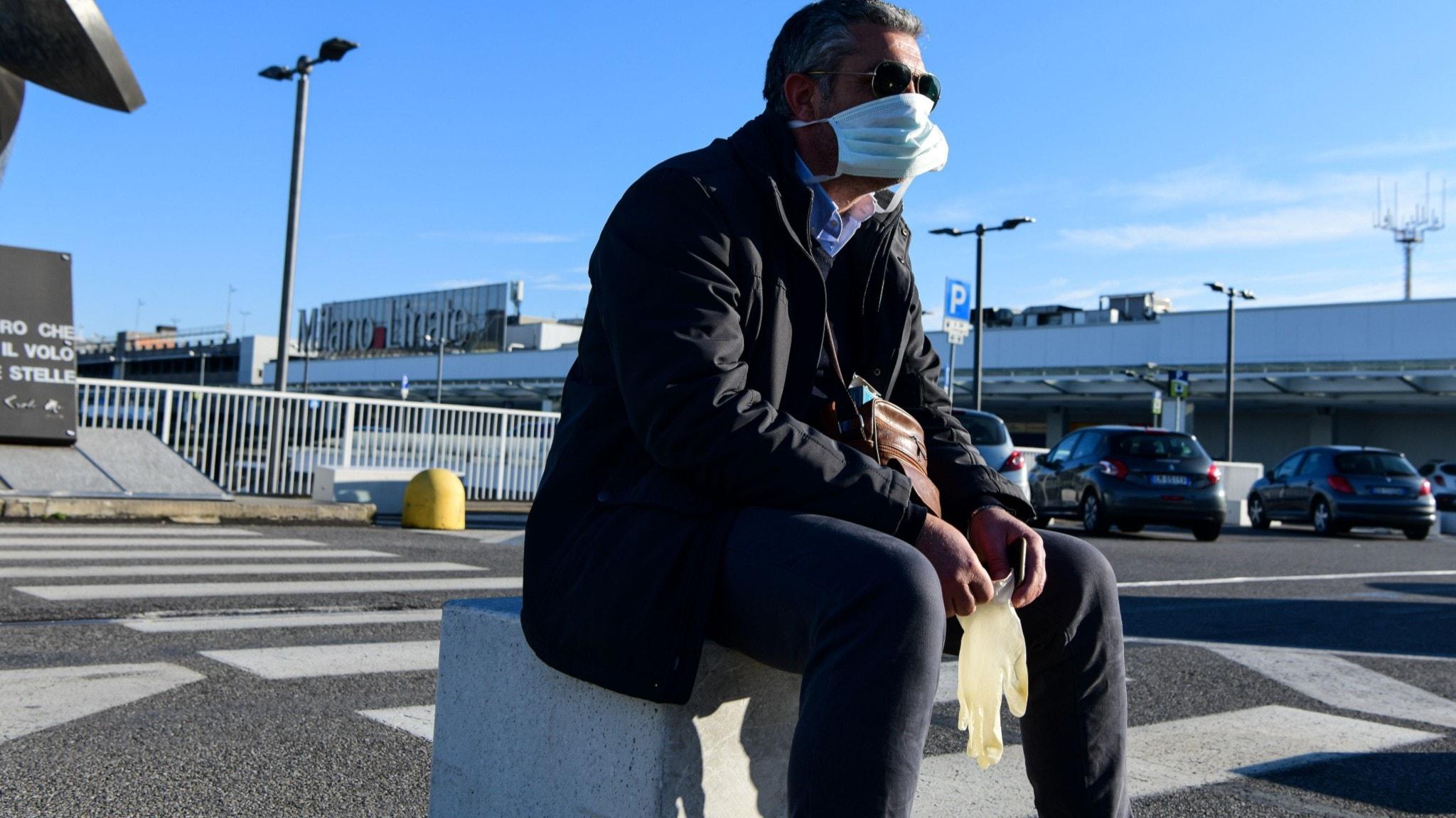 Italienare med munskydd