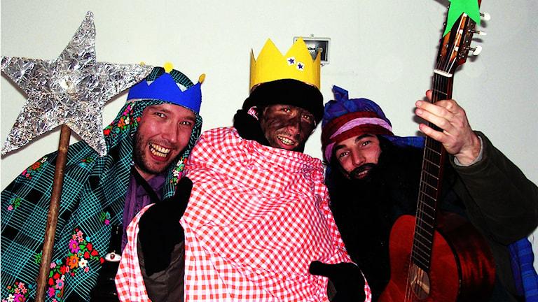 Tre herrar utklädda till de tre vise männen