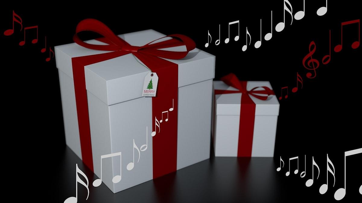 Julklappar som det strömmar musik och noter ur.