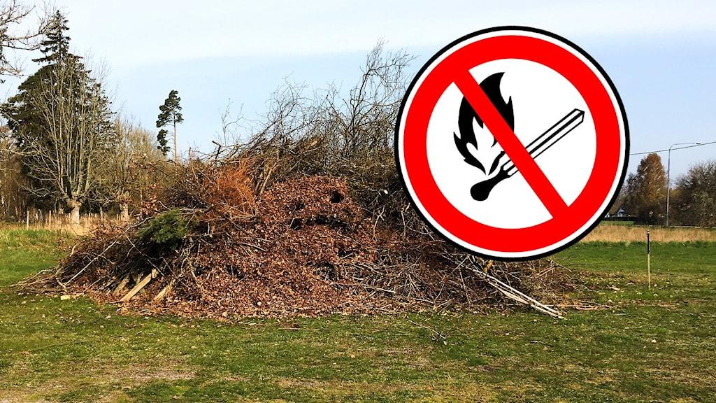 En rishög förberedd för valborgsmässoeld och en symbol för eldningsförbud.