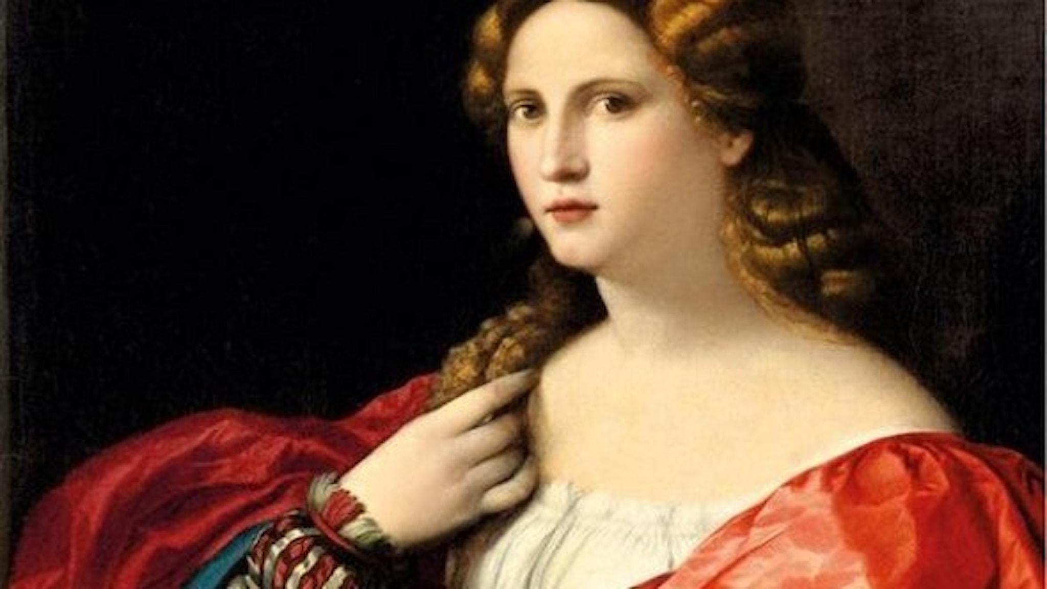 Porträtt av en ung kvinna med röd klänning och ljust lockigt hår