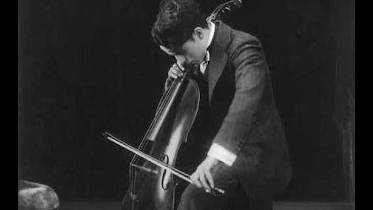 Charlie Chaplin playing the cello 1915
