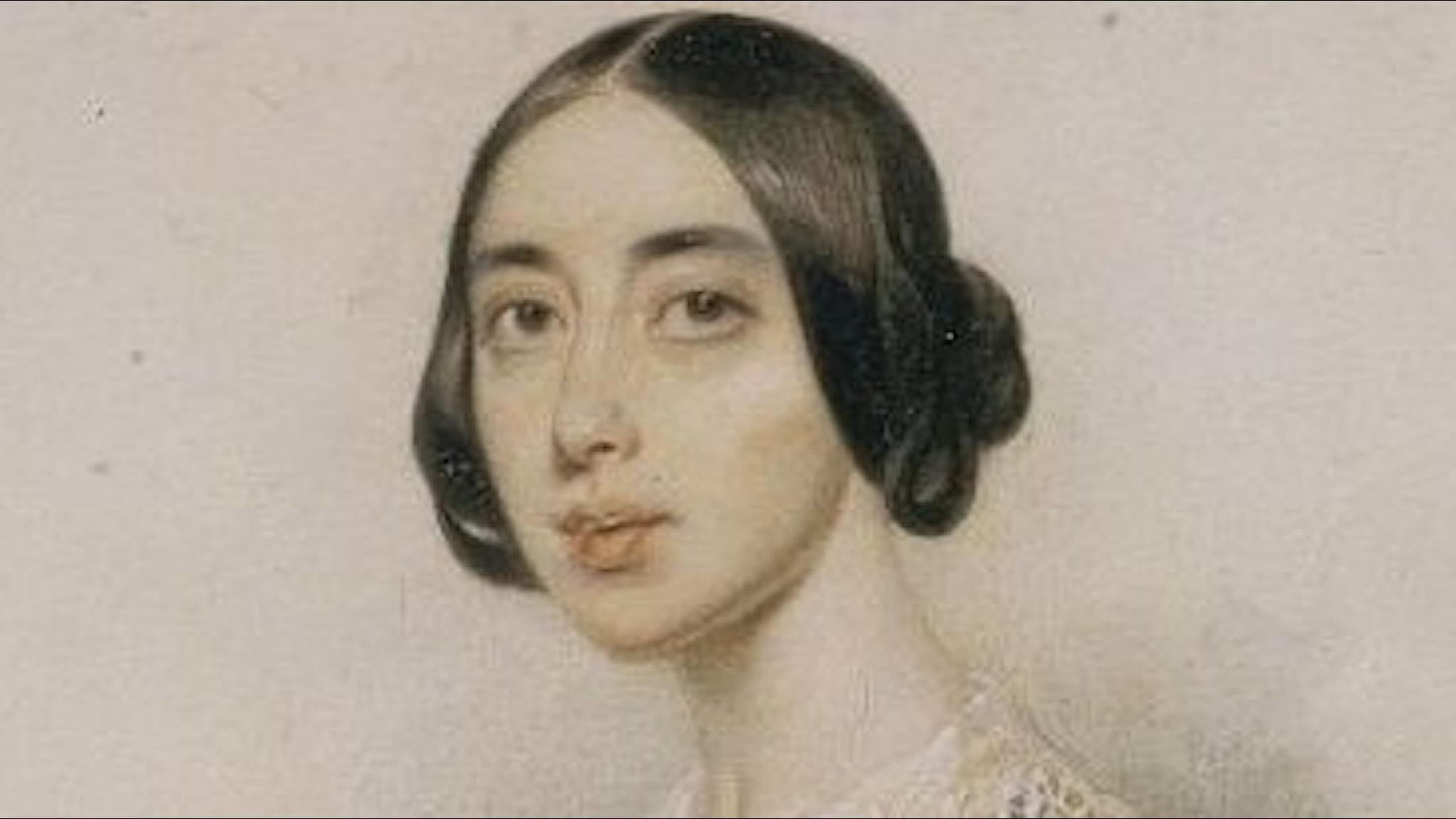 Flicka med 1800-talsfrisyr, och spetskrage.
