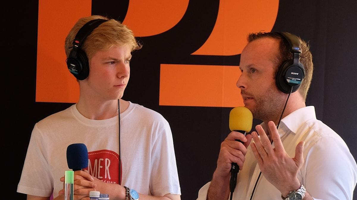 Axel Hallberg (Grön ungdom) debatterar mot Christian Karlsson (KDU).
