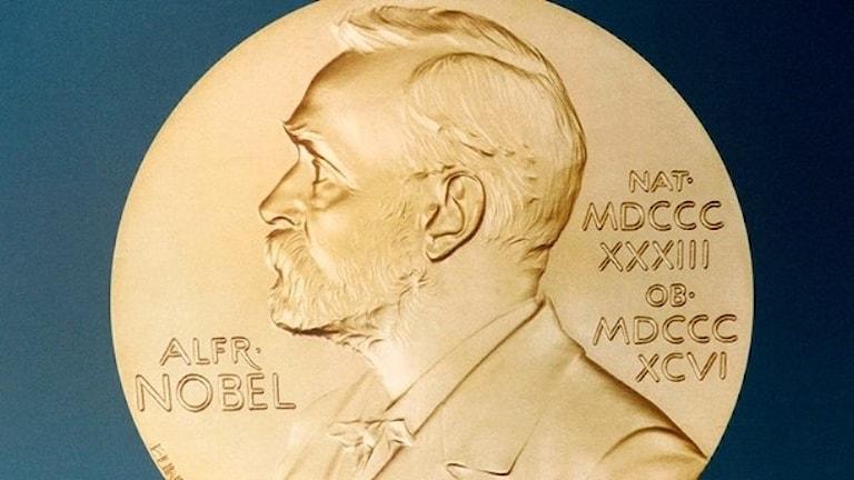 The gold Nobel medal.