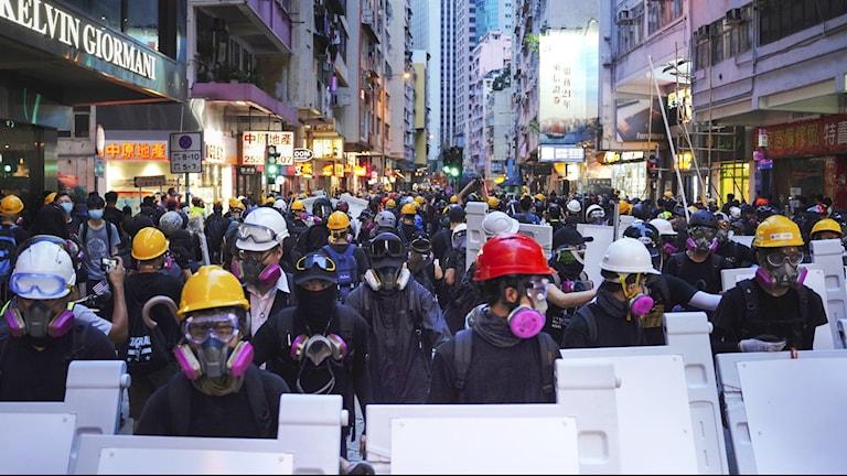 Journalister har attackerats i samband med protester i Hongkong.
