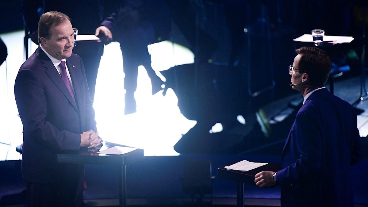 Stefan Löfven och Ulf Kristersson i en debatt.