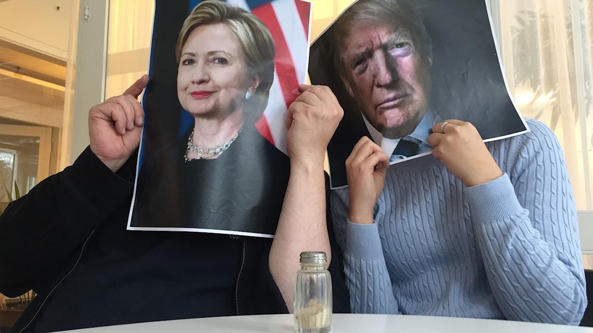 Jorma Ikäheimo ja Marika Pietilä Hillary Clintonin ja Donald Trumpin takana.