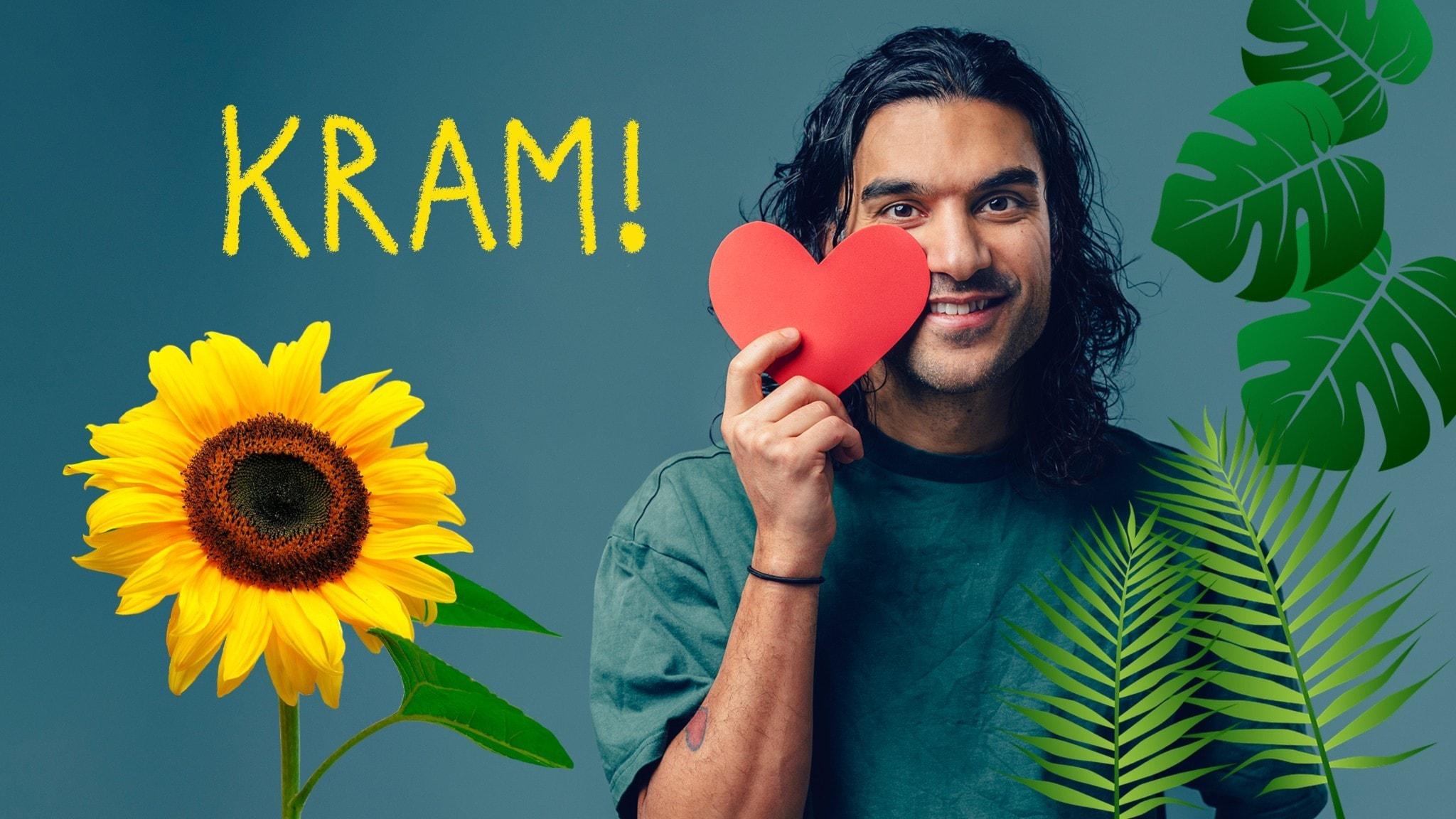 Farzad håller i ett hjärta och det är många gröna blad och växter i bilden. Foto: Alexander Donka