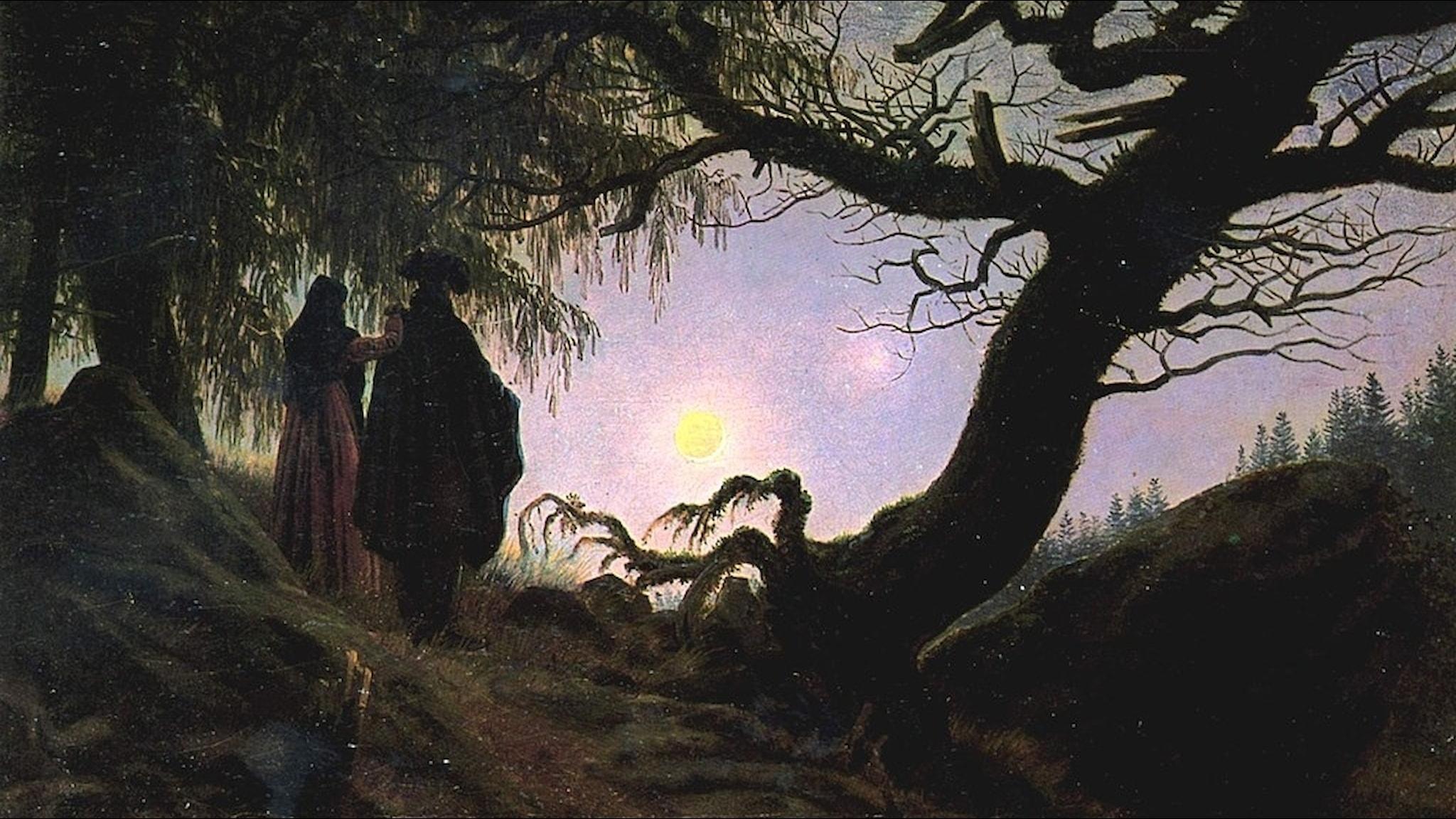 Mann und Frau den Mond betrachtend