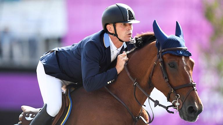 Peder Fredricson tillsammans med hästen All In.