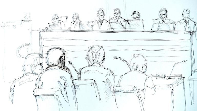 Rakhmat Akilov i rättegången. (Det är förbjudet att fotografera i rättssalen. Därför är bilden tecknad.) Foto: Johan Hällnäs / TT