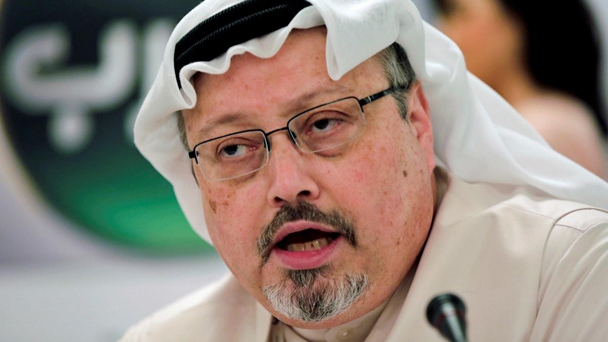 På fotot ser man en man som har en arabisk huvudbonad.