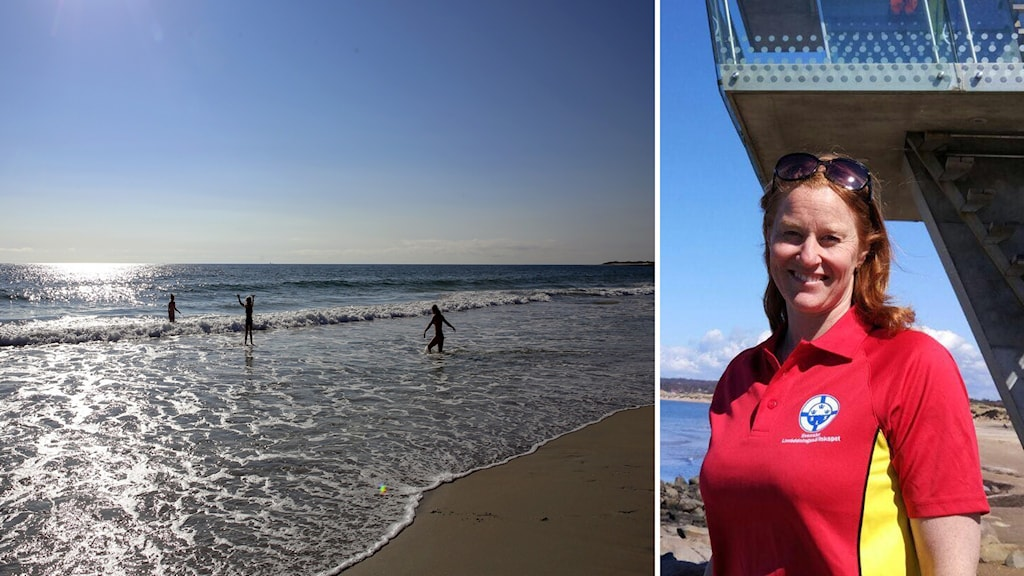 På bildens högra sida ser man en ljushårig kvinna i röd tröja som står framför ett utsiktstorn. På bildens vänstra sida ser man solen som blänker i havet och några personer som badar.