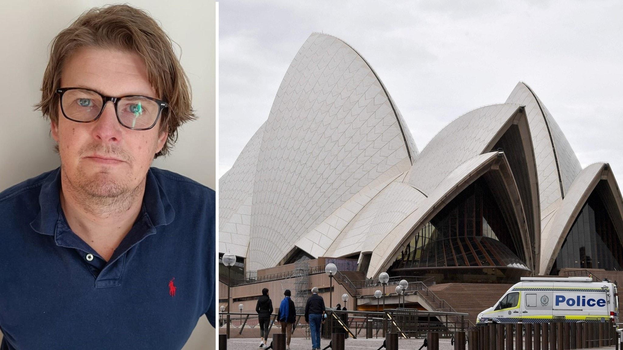 På bildens vänstra sida är en man i glasögon och blå tröja. Till höger syns Sydneys operahus, med sina typiska snäckformade byggnader.