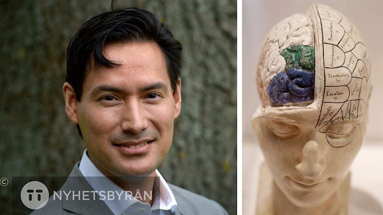 Simon är klädd i kavaj och skjorta, men har ingen slips. Bredvid honom finns bilden på en hjärna.