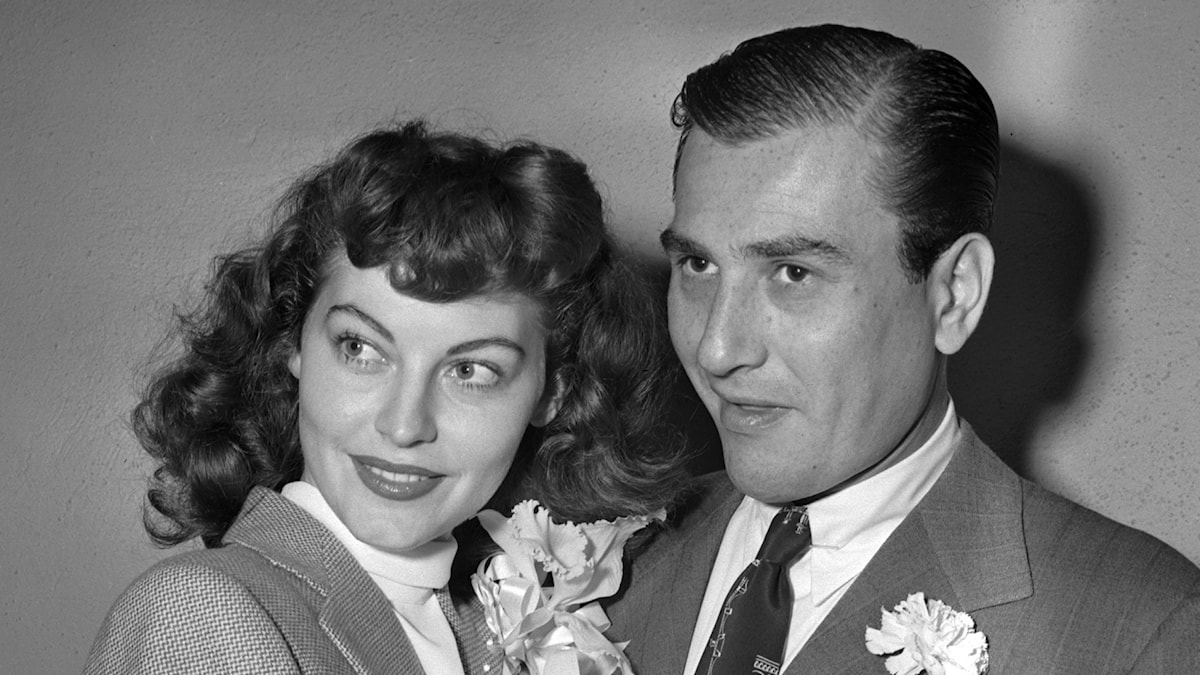 Artie Shaw takes his bride, actress Ava Gardner, into his arms after their wedding in this Oct. 17, 1945