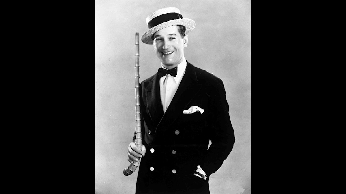 Maurice Chevalier posing with straw hat and walking stick, in New York, USA, on Oct. 17, 1930.