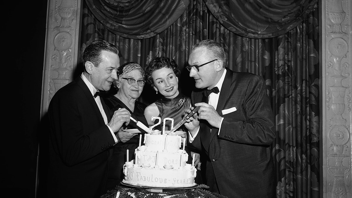 This was a happy occasion for Tommy Dorsey right, and his brother, Jimmy, when they cut a cake in New York on Jan. 11, 1955, celebrating their 20th anniversary as band leaders.