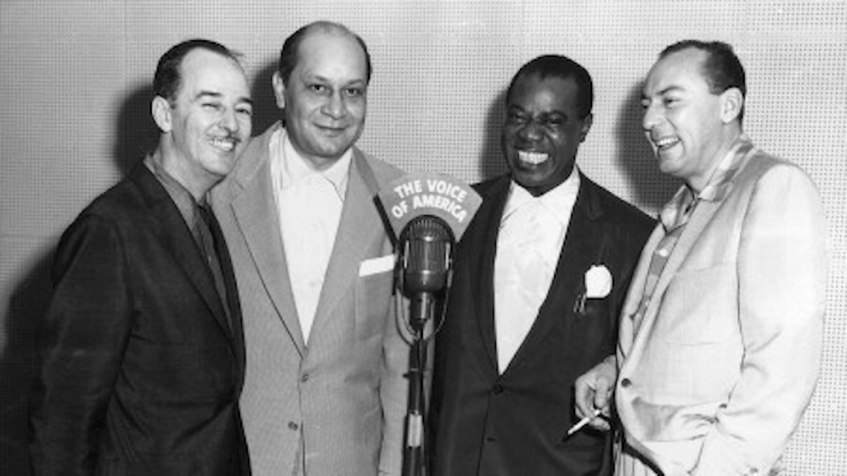 Bobby Hackett, Barney Bigard, Louis Armstrong and Woody Herman, in Washington for the American Jazz Festival, meet for a Voice of America interview.