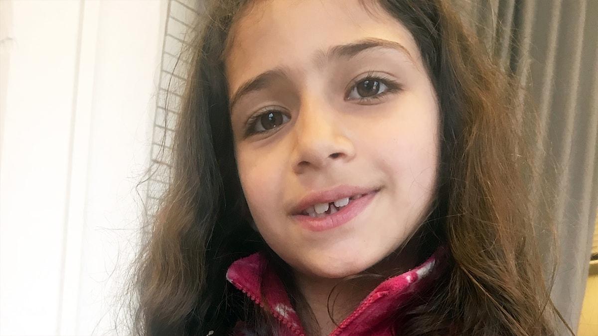 Enola, 7 år från Syrien.